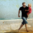 Father and daughter on the beach. Photo in old image style.  — Stock Photo