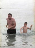 Father and son on the sea. Photo in old color image style. — Stock Photo