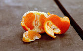 Tangerines on a natural wooden table — Stock Photo