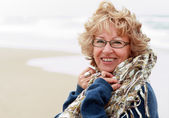 Portrait of happy senior woman at sea — Stock Photo