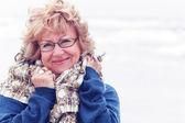 Portrait of happy senior woman at sea — Stock Photo