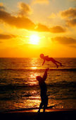 Father and son on a walk by the sea — Stock Photo