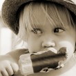 Cute girl in the hat eating ice-cream — Stock Photo #26125439