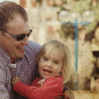 Portrait of happy father and his adorable little daughter — Stock Photo #26125529
