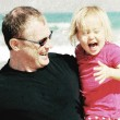 Portrait of father and daughter on the beach. Photo in old image — Stock Photo