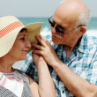 Happy elderly couple enjoying their vacation near the sea — Stock Photo