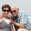 Happy elderly couple enjoying their retirement vacation near the sea — Stock Photo
