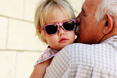 Grandfather holding his 2 year old granddaughter — Stock Photo