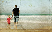 Father and daughter on the beach — Stok fotoğraf
