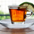 Cup of tea with lemon standing on wooden table — Foto Stock