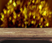 Vintage wooden table with heart bokeh background — Stock Photo