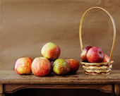 Fresh apples on wooden table — Stock Photo
