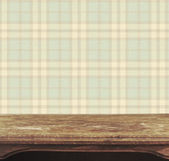 Background with wooden deck table on Scottish plaid Background — Stock Photo