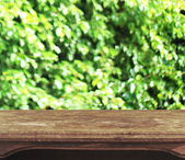 Vintage wooden table with natural heart bokeh background — Stock Photo