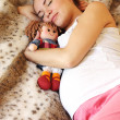 Sleeping pregnant woman on the bed — Stock Photo #36553377