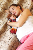 Sleeping pregnant woman on the bed — Stock Photo