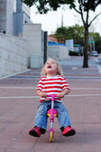 Cute little girl with bycicle — Stock Photo
