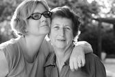 Portrait of beautiful senior woman and her adult daughter — Stock Photo