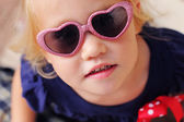 Portrait of cute 2,5 years old baby with fashion sunglasses — Stock Photo