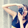 Stock Photo: Woman with old camera