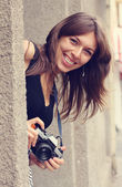 Smilling woman with camera — Foto Stock