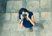 Woman with old camera — Stock Photo