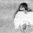 Stock Photo: Little naked newborn baby sleeping with angel wings
