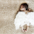Little naked newborn baby sleeping with angel wings — Stock Photo