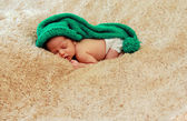 Newborn baby is wearing a blue hat and laying down sleeping — Stock Photo
