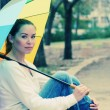 Woman with rainbow umbrella — Stock Photo #41734523