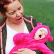 Stock Photo: Mother and baby yawn
