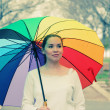 Woman with colorful umbrella — Stock Photo #41734819