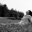 Mature woman sitting in grass — Stock Photo