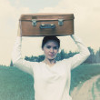 Woman with suitcase — Stock Photo #41734857