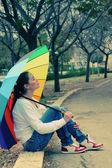 Woman under big umbrella — Стоковое фото