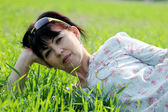 Mature woman lying in grass — Stock Photo