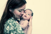 Mother kiss baby. — Stock Photo