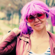Beautiful young woman with pink sunglasses and purple hair — Stock Photo