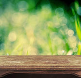 Vintage wooden table with natural bokeh background — Stock Photo