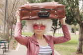 Woman with vintage bag — Stock Photo