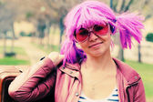 Beautiful young woman with pink sunglasses and purple hair — 图库照片
