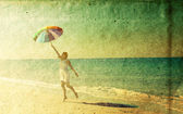 Woman with umbrella. Photo in old color image style. — Stock Photo