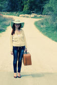 Woman with old vintage bag. Photo in old color image style. — Stock Photo