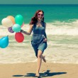 Young redhead woman holding colorful balloons — Stock Photo #45577523