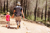 Father hiking with kid — Stock Photo