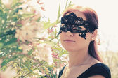 Portrait of beautiful woman in mask outdoors — Stock fotografie