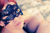 Portrait of beautiful woman in mask outdoors — Stock Photo