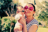 Portrait of happy loving mother and her baby outdoors — Stock Photo