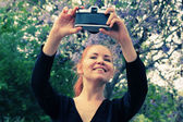 Woman taking picture of herself — Stock Photo