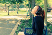 Woman with Headphones Outdoors — Zdjęcie stockowe